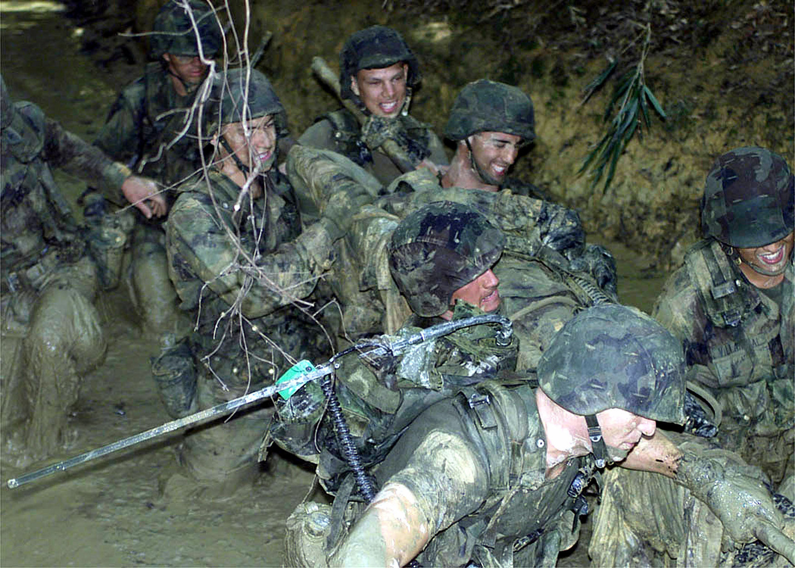 US Marines from the 3D Marine Division Communication Company, carry