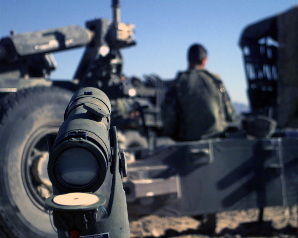 US Marines of Third Battalion, Eleventh Marines, First Marine Division use a collimator as a primary aiming reference for the M198 155mm Medium Howitzer, during the final exercise of COMBINED ARMS EXERCISE (CAX) 2-01 at Marine Corps Air Ground Combat Center (MCAGCC) 29 Palms, California