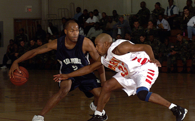 All-Marine Guard Billy Shanks, goes for the steal as All-Air Force Guard Tyrone Wilson dribbles behind his back to protect the ball during Air Forces' 67-59 over the Marines at the 2000 Armed Forces Basketball Championships. Competition between Army, Navy, Air Force, and Marines at the championship promotes understanding, goodwill, cooperation, and provides a means of selecting teams and individuals to represent the Armed Forces in national and international championships. Participants are selected as a result of highly competetive trial camps or resume by each of the respective services. At the conclusion of the championship, an Armed Forces team will be selected to compete at the US ...
