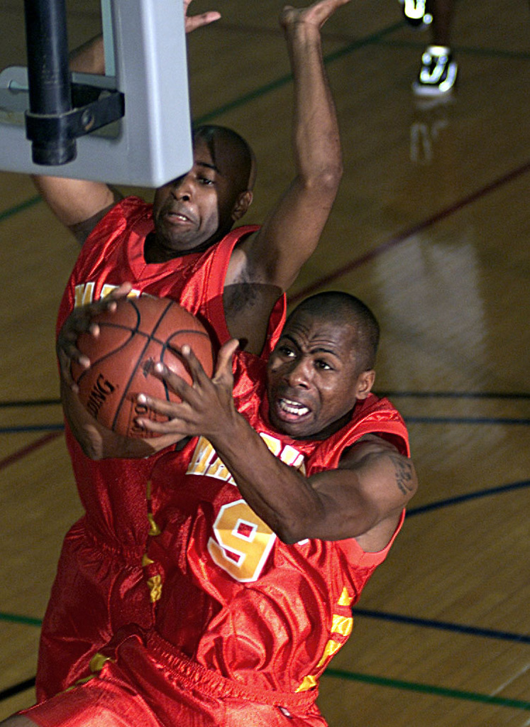 US Marine Corps Lance Corporal Robert Moore, All-Marine Guard, grabs a rebound during the 2000 Armed Forces Basketball Championships. Competition between Army, Navy, Air Force, and Marines at the championship promotes understanding, goodwill, cooperation, and provides a means of selecting teams and individuals to represent the Armed Forces in national and international championships. Participants are selected as a result of highly competetive trial camps or resume by each of the respective services. At the conclusion of the championship, an Armed Forces team will be selected to compete at the US Nationals or the Conseil International de Sport Militaire (CISM) championship