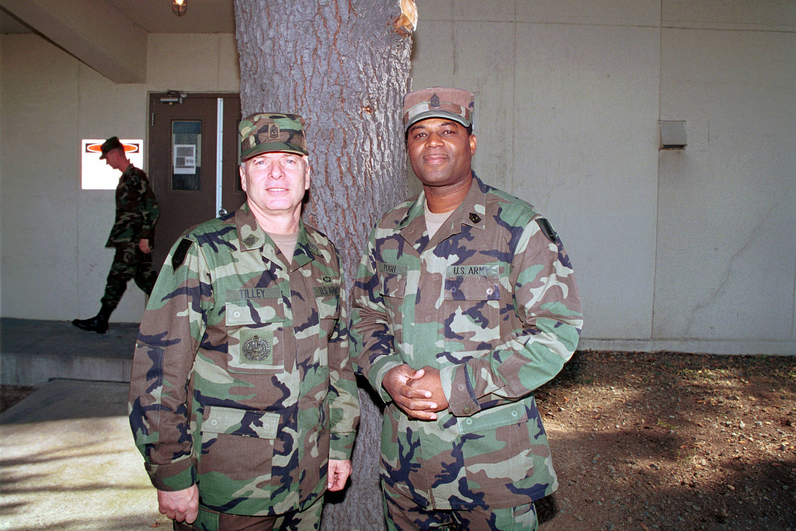 Sergeant Major of the Army Jack L. Tilley, left, poses for a picture with First Sergeant Pugh, from Charlie Company, 1ST Battalion, 52nd Aviation Regiment, and 17th Aviation Brigade, at the end of his tour of Camp Carroll