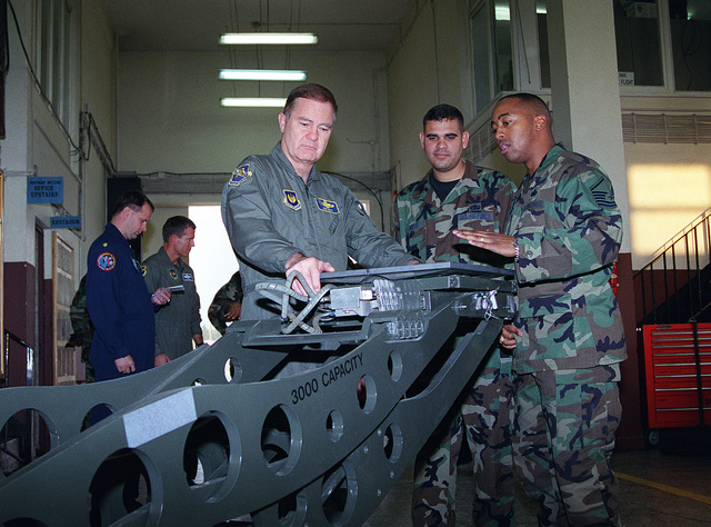 US Air Force MASTER Sergeants Oliver McCoy (right) and Lucrecio Brito (center), 39th Maintenance Squadron, explain the workings of a HU-38 Bomb Loader to US Air Force Lieutenant General Ronald Keys, 16th Air Force commander, during the GEN Key's visit to Incirlik Air Base, Turkey