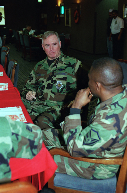 US Air Force General (GEN) Michael Ryan, Air Force CHIEF of STAFF, talks with a MASTER Sergeant from the 39th Fighter Wing, Incirlik Air Base, Turkey, as they enjoy a Thanksgiving Day meal, during the General's visit to the Base