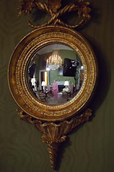 Photograph of First Lady Hillary Rodham Clinton's Reflection in a Mirror in the Green Room at the White House