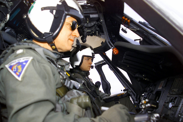 US Navy Commander Rick Scudder and US Navy Lieutenant Greg Leland execute systems checks on an SH-60F helicopter from Antisubmarine Warfare Squadron Seven (HS-7) prior to flight operations on board USS HARRY S. TRUMAN (CVN 75). Truman is on its maiden deployment transiting to the Mediterranean Sea