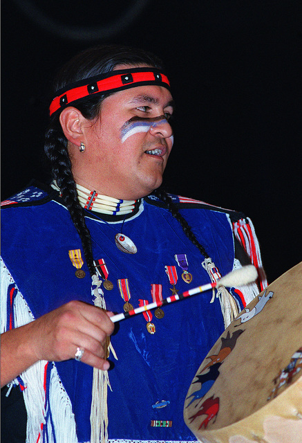 In celebration of Native American History Month, Burton Rojas, plays the drums and chants with the Morning Star Dancers. The Dancers performed in front of more than 475 people (not shown) during their visit to Incirlik Air Base, Turkey