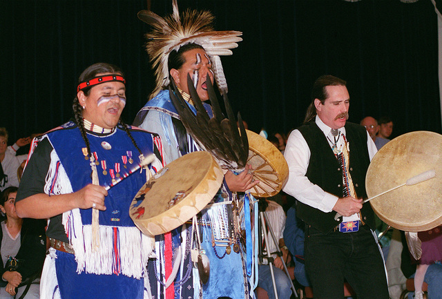 In celebration of Native American History Month, (from left to right) Burton Rojas, Kelly Rainer and Gary Fields drum and sing with the Morning Star Dancers. The dancers performed in front of more than 475 people during their visit to Incirlik Air Base, Turkey