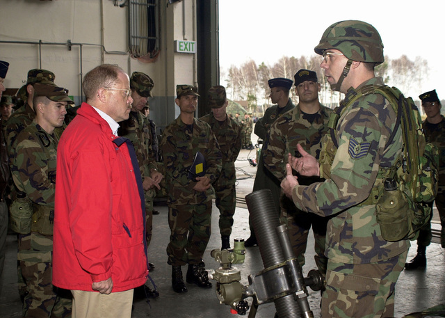 The Honorable F. Whitten Peters, Secretary of the Air Force (SECAF), gets briefed on some of the equipment the Contingency Response Group (CRG) uses in the field, during his tour of the 86th Airlift Wing, Ramstein Air Base, Germany