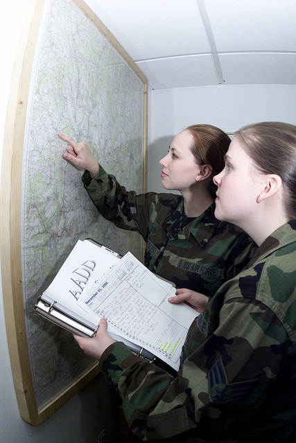 US Air Force SENIOR AIRMAN (SRA) Michelle Almarode (right) 52nd Mission Support Squadron and SRA Amanda Gonzalez, 52nd Fighter Wing, look at the local map in their new AIRMAN Against Drunk Drivers facility at Spangdahlem Air Base, Germany. SRA Gonzalez is the president of the AADD program and SRA Almarode is the vice president of the program