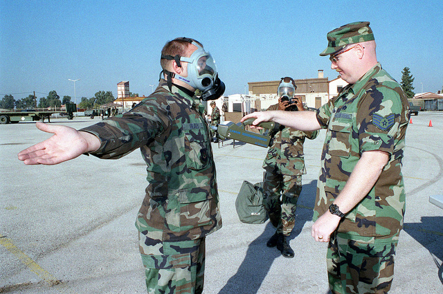 During the Quarterly 39th Wing Readiness Day at Incirlik Air Base, Turkey, US Air Force STAFF Sergeant David Whaley checks for contamination on US Air Force STAFF Sergeant Michael Dealy with a chemical agent monitor in station six of the Chemical Control Area