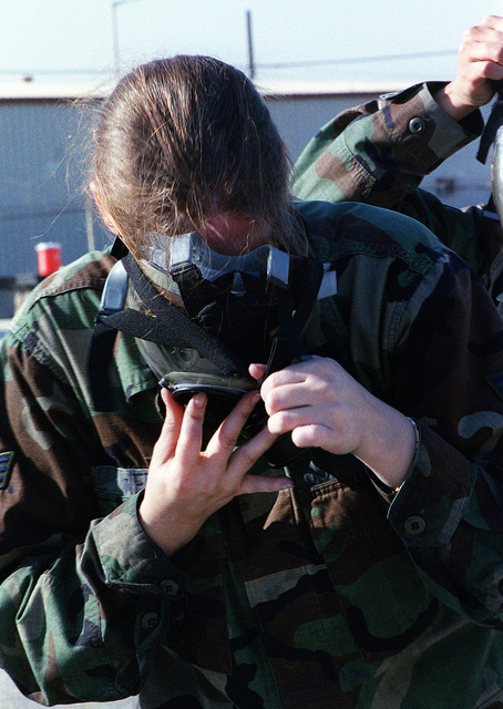 US Air Force SENIOR AIRMAN Rachelle Weberremoves her gas mask after participating in the Chemical and Biological exercise for the 39th Wing Readiness Day, at Incirlik Air Base, Turkey
