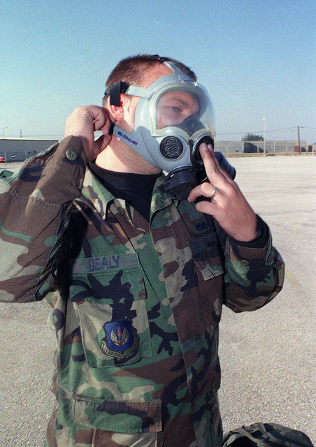 US Air Force STAFF Sergeant Michael Dealy prepares to remove his MCU-2P gas mask after participating in the Chemical and Biological exercise for the 39th Wing Readiness Day at Incirlik Air Base, Turkey
