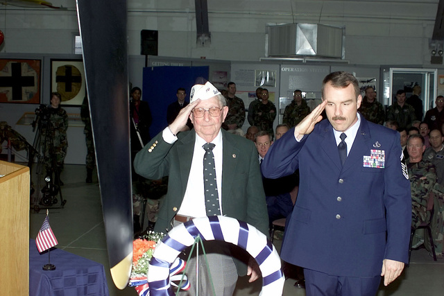 A Delaware area Pearl Harbor survivor and a US Air Force member participate in the wreath ceremony during the Pearl Harbor Day Remembrance Ceremony held at the Air Mobility Command (AMC) Museum, Dover Air Force Base, Delaware