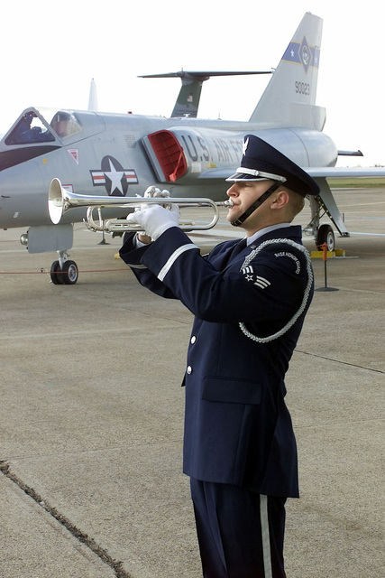 A member of the Dover Air Force Base Honor Guard plays taps during the Pearl Harbor Day Remembrance Ceremony held at the Air Mobility Command (AMC) Museum, Dover Air Force Base, Delaware