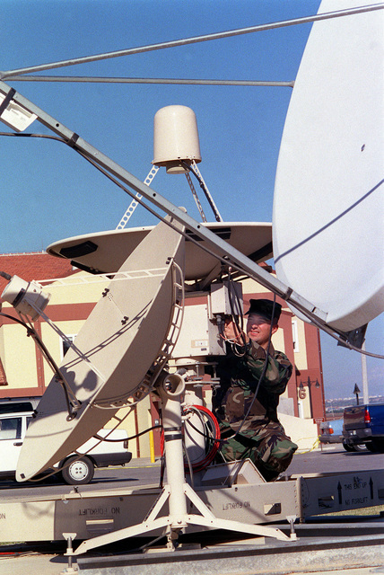 US Air Force STAFF Sergeant Greg Strong of the weather flight, adjusts a weather satellite dish to get optimum signal reception, at Incirlik Air Base, Turkey