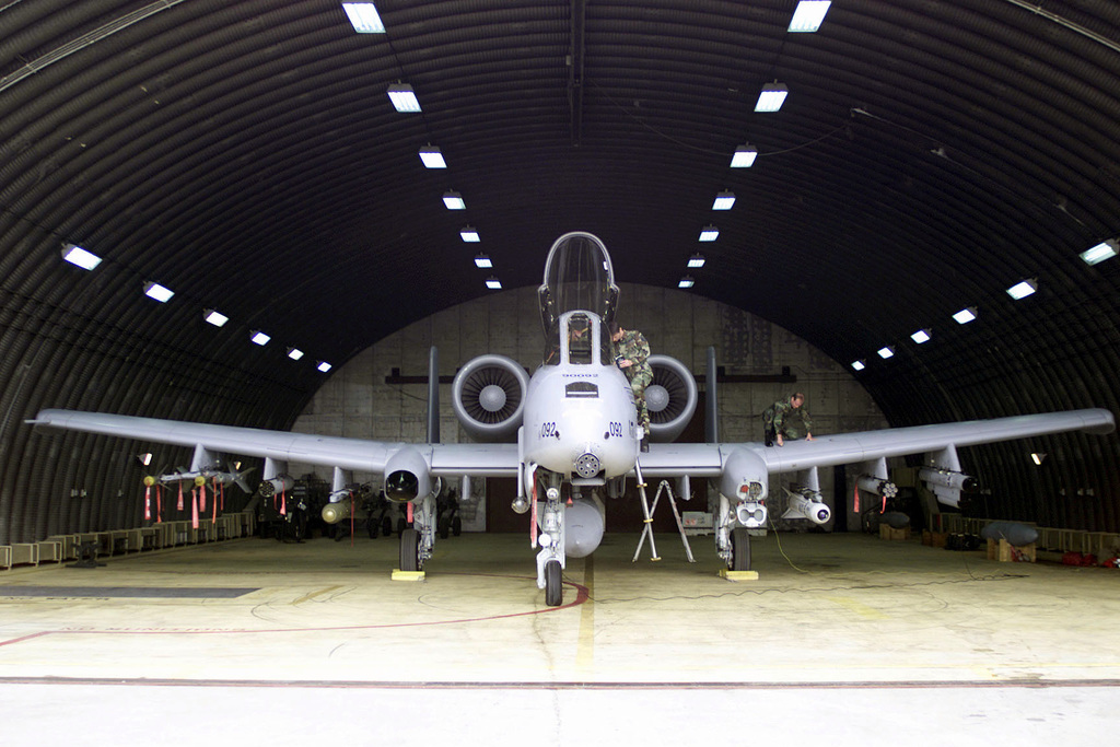 Crew chiefs from the 303rd Expeditionary Fighter Sqaudron, Whiteman Air Force Base, Missouri, perform routine checks on an A-10 Thunderbolt aircraft at Incirlik Air Base, Turkey in support of Operation NORTHERN WATCH