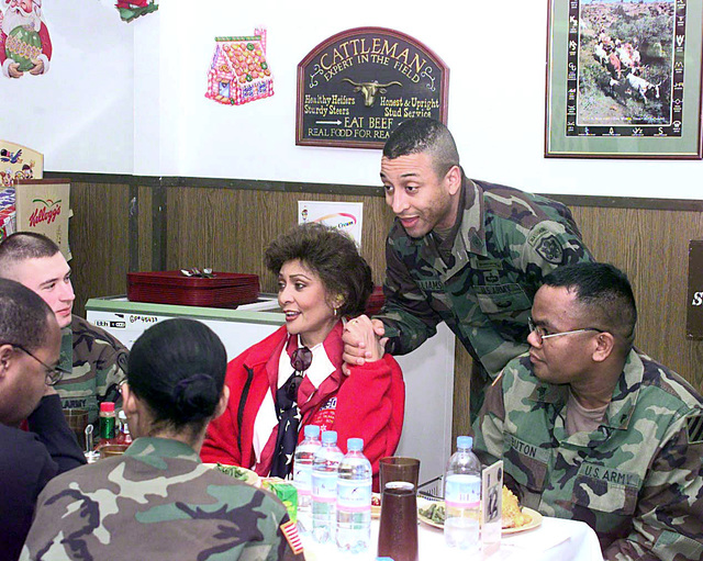 Mrs. William S. Cohen, wife of the Secretary of Defense, visits Eagle Base, Tuzla, Bosnia and Herzegovinia with The USO Show. After arrving at Eagle Base, Mrs. Cohen had dinner with the soldiers that are deployed here. This is Mrs. Cohens last visit to Eagle Base before her husband leaves office