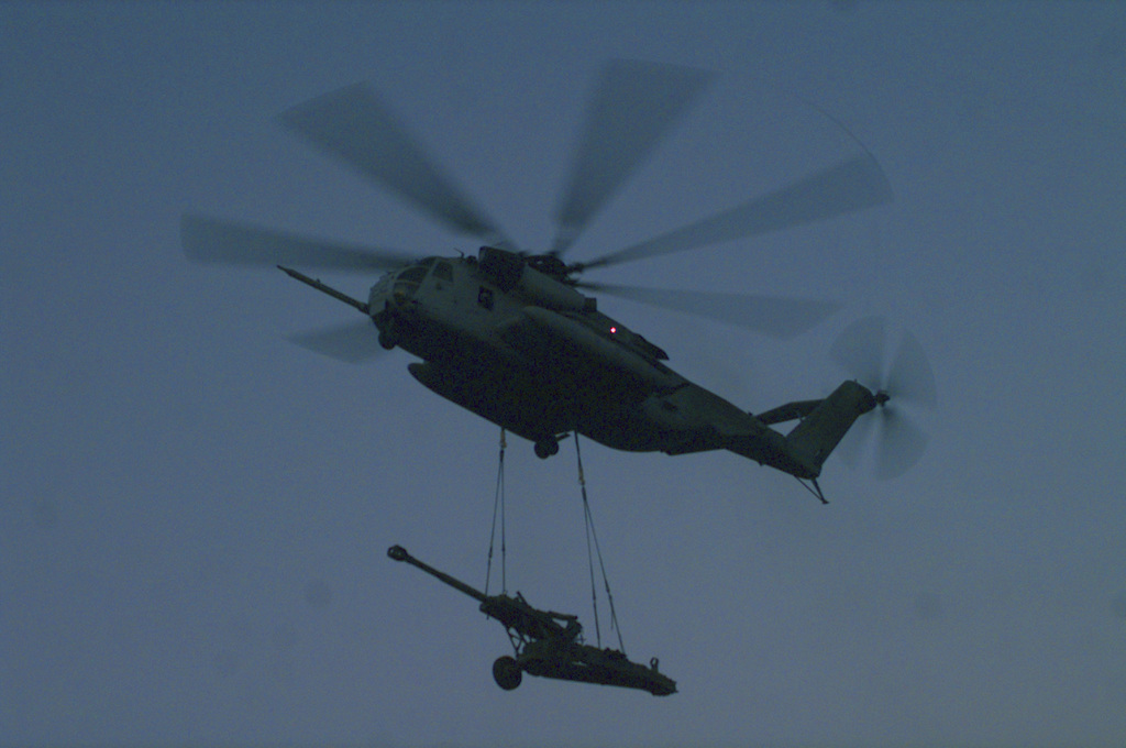 """A United States Marine Corps Cargo Helicopter, CH-53E, from Marine Helicopter Squadron 268, Third Marine Air Wing transports a M198 155mm Medium Towed Howitzer at Camp Pendleton, California during a training exercise conducted by Battery """"R"""", Fifth Battalion, Eleventh Marines. The CH53E is able to externally lift 73,500 pounds. The M198 weighs 15,758 pounds"""