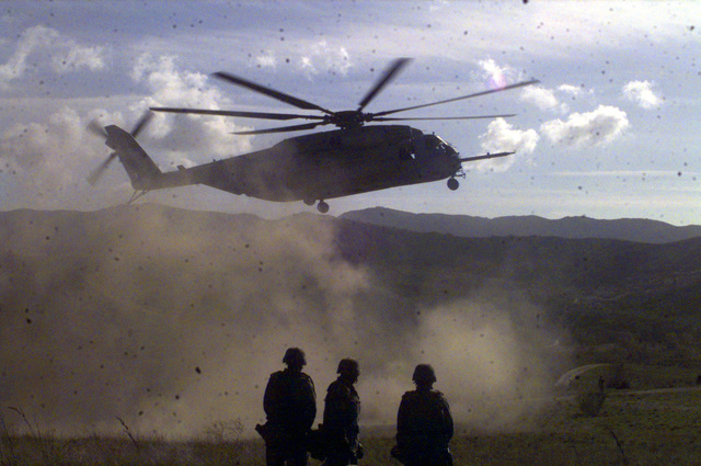 "A US Marine Corps Cargo Helicopter, CH-53E, from Marine Helicopter Squadron 268, 3rd Marine Air Wing lands at Camp Pendleton, California prior to transporting four M198 155mm Medium Howitzers for a training exercise conducted by Battery ""R"", Fifth Battalion, Eleventh Marines,. The CH-53E is able to lift externaly 73,500 pounds"