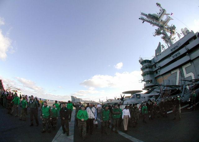 Prior to flight operations, crewmembers conduct a Foreign Object Damage (FOD) walk down on the flight deck on board USS Harry S. Truman (CVN 75). Fod walk downs are conducted daily to minimize damage to aircraft engines and injury to personnel. TRUMAN is on a scheduled six-month deployment to the Mediterranean Sea and Arabian Gulf