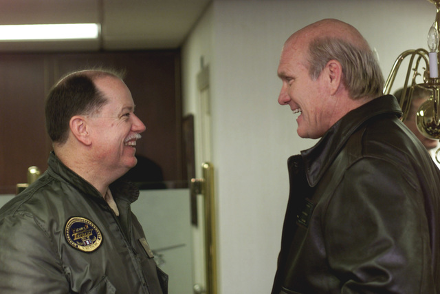 Fox Sports celebrity Terry Bradshaw shares a laugh with Captain David L. Logsdon, Commanding Officer of USS Harry S. Truman (CVN 75). The Fox Sports host is on board to tape the popular NFL Pre-Game Show aired on the FOX Network, December 16th and 17th. TRUMAN is on a scheduled six-month deployment to the Mediterranean Sea and Arabian Gulf