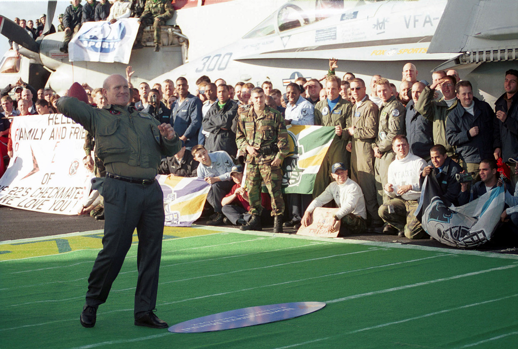 FOX NFL Sports host Terry Bradshaw launches a football into the crowd of Sailors and Marines that gathered on the flight deck of USS HARRY S. TRUMAN (CVN 75) to watch the taping of the Fox NFL Pre-Game Show. TRUMAN is on a scheduled six-month deployment to the Mediterranean Sea and Arabian Gulf