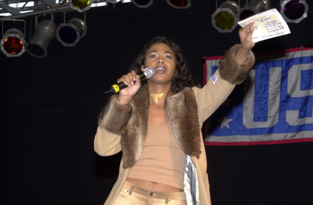 Ananda Lewis, MTV VJ and this years emcee for theSecretary of Defense's Holiday Show 2000, addresses the audience at Ramstein Air Base, Germany
