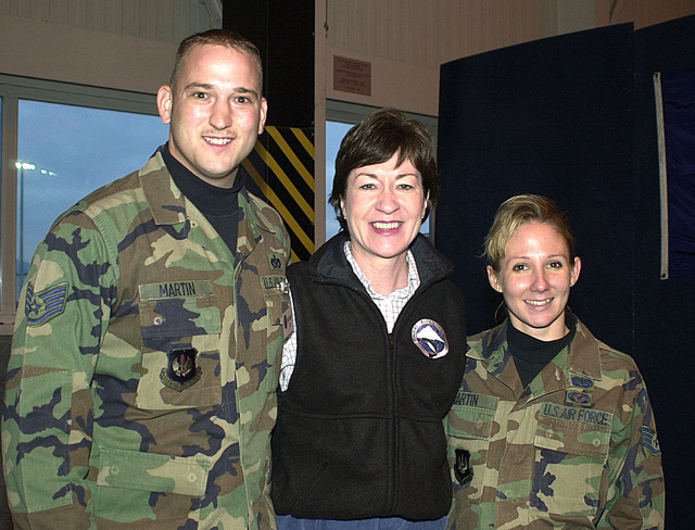 Senator Susan Collins of Maine, meets with US Air Force STAFF Sergeants Keith & Katrina Martin. Both are assigned to Ramstein Air Base, Germany, where the Secretary of Defense Holiday Tour 2000, took place on December 17th, 2000