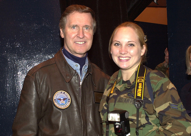 US Air Force AIRMAN First Class Tia Deatrick, a Photographer, assigned to the 786th Communications Squadron, Ramstein Air Base, Germany. She poses with the Honorable William S. Cohen, US Secretary of Defense, at the Secretary of Defense Holiday Show 2000, taking place Ramstein AB, on December 17th 2000