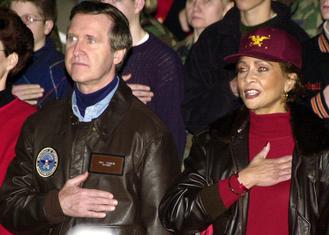 US Secretary of Defense William Cohen and first lady of the Pentagon, Janet L. Cohen, show their Patriotism at the Secretary of Defense Holiday Show 2000, at Ramstein Air Base, Germany, on December 17th, 2000