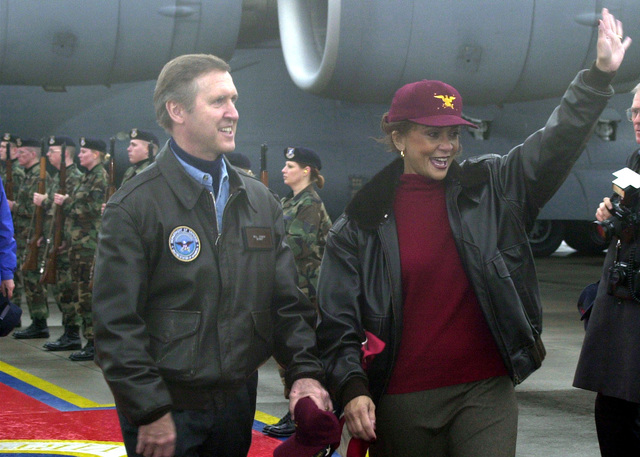 US Secretary of Defense William Cohen and first lady of the Pentagon, Janet L. Cohen, arrive at Ramstein Air Base, Germany, to celebrate the Holiday Show 2000 with service members and their families on December 17th, 2000