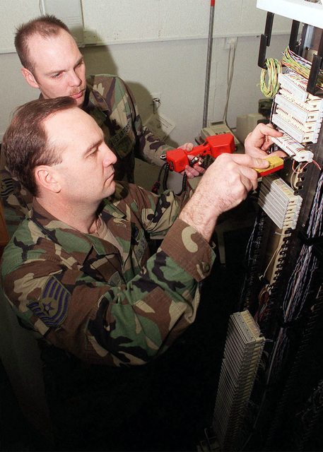 US Air Force Technical Sergeant Ricky Deeson, a telephone maintenance technician and USAF Technical Sergeant Bill Northington, a Non-Commissioned Officer in Charge (NCOIC) of network security, both from the 48th Communications Squadron (CS), 48th Fighter Wing, Royal Air Force Lakenheath, United Kingdom, terminate a new local area network circuit at the 48 CS server farm