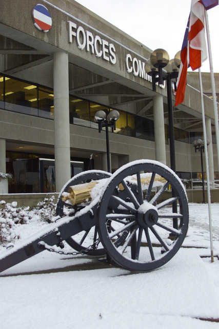 View of cannon in front of Marshall Hall, Forces Command (FORSCOM) headquarters, Fort McPherson, GA, after a surprise snowfall a week before Christmas