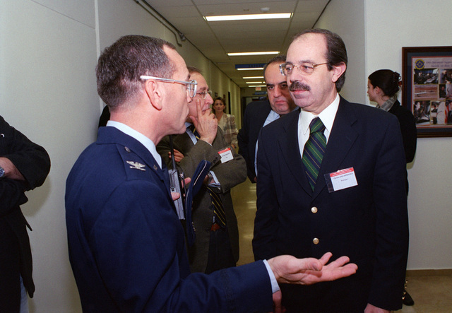 Carlo Encarnacao, a member of the Portuguese parliament speaks with 39th Vice Wing Commander, Colonel Charles Hale, during a North Atlantic Treaty Organization (NATO) Parliamentary Assembly Subcommittee on Transatlantic Defense and Security Cooperation, at Incirlik Air Base, Turkey