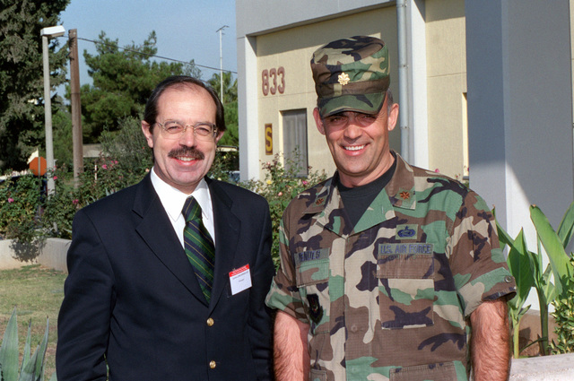 Mr. Carlo Encarnacao (left), a member of the Portuguese Parliament and US Air Force (USAF) Major (MAJ) Candido Mendes, Commander, 39th Mission Support Squadron, pose for a photograph during the National Atlantic Treaty Organization (NATO) Parliamentary Assembly Subcommittee on Transatlantic Defense and Security Cooperation's visit at Incirlik AB, Turkey