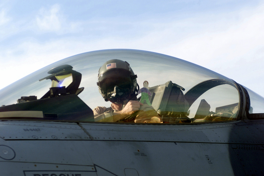 """US Air Force Brigadier General Bob DuLaney, co-commander for coalition forces assigned to Operation NORTHERN WATCH, and his """"co-pilot"""" Stanley prepare to launch in an F-16 Fighting Falcon aircraft. The real mission of the sortie is to educate the children of America on the mission being preformed here at Incirlik Air Base, Turkey"""