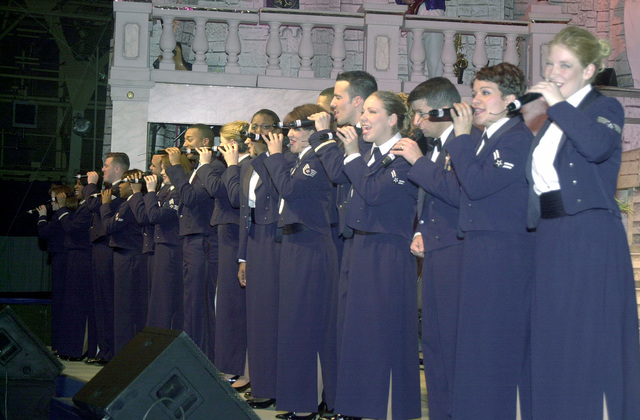 Members of the Air Force's premier entertainment showcase, Tops in Blue, perform the Air Force song during a performance at Misawa Air Base, Japan, on New Years Eve 2000