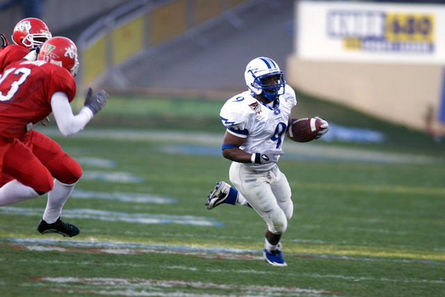 US Air Force Academy Falcon Cadet Third Class Leotis Palmer gains yardage on a kick return during the first ever Silicon Valley Football Classic Bowl game