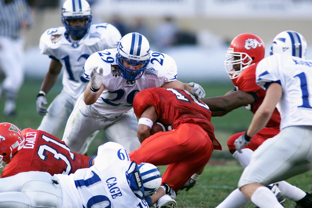 US Air Force Academy Falcons Cadet First Class Travis Logsdon, and Cadet Second Class Tre' Cage, stop the Bulldogs for no gain during the first ever Silicon Valley Football Classic Bowl game on December 31, 2000