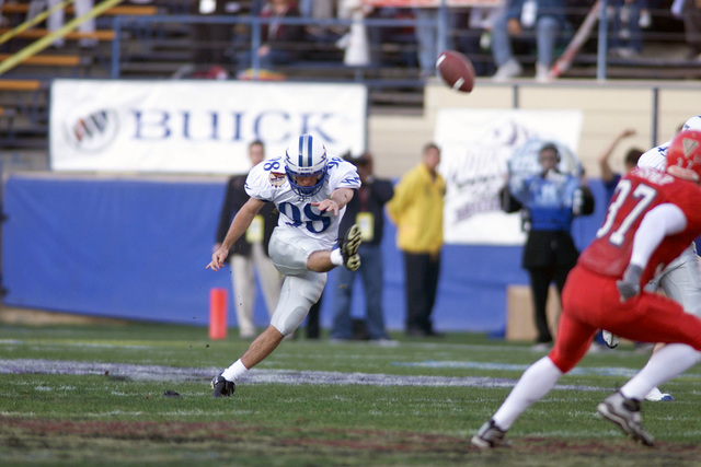 US Air Force Academy Falcons Special Team's Most Valuable Player (MVP), Cadet First Class Dave Adams, kicks off during the first half of the Silicon Valley Football Classic Bowl game. Air Force finished with a 37-34 victory over Fresno State