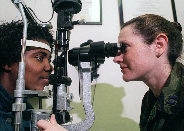 Captain Michelle Koe, USAF, (right), Optometrist, 48th Aerospace Medical Squadron, 48th Fighter Wing, RAF Lakenheath, UK, performs a bio-microscopic evaluation on the retina of Kolloh Lee, dependent of STAFF Sergeant Robyn Lee, USAF, 21st Special Operations Squadron, RAF Mildenhall, UK
