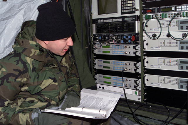 AIRMAN First Class (A1C), Joshua Ratcliff, USAF, Satellite Technician, Air Expeditionary Wing Communications Element, 4th Communications Squadron, Seymour Johnson AFB, NC works to program a satellite modem in preparation for a Base wide Operational Readiness Inspection