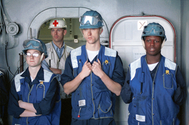 (from left to right) US Navy SEAMAN Kristin L. Wierzba, US Navy SEAMAN Zachary D. Bendickson and US Navy SEAMAN Tershea S. Ewell awaits connection with a supply ship for a connected replenishment on board USS HARRY S. TRUMAN (CVN 75). Truman is on station in the Persian Gulf to support operation SOUTHERN WATCH