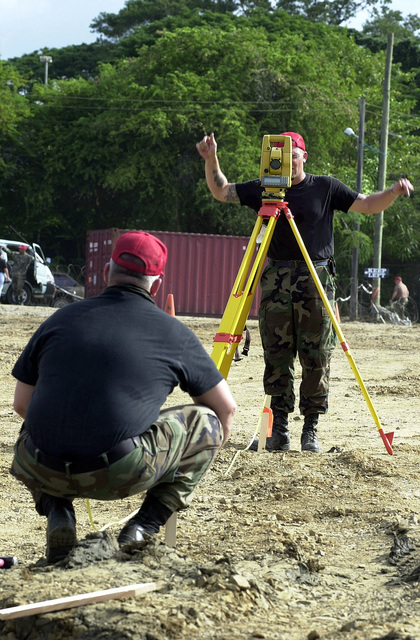 US Air Force Technical Sergeant Gary Kofford from the 820th Red Horse Squadron, Nellis Air Force Base, Nevada, places a stake in the ground, while US Air Force member Michael Geer directs him on correct placement during the setup portion of Operation NEW HORIZONS. Approximately 100 Marine, Army and Air Force personnel have deployed to Castries, Saint Lucia, as part of New Horizons. The operation has a two fold mission of readiness training and humanitarian assistance in the Caribbean and Latin America