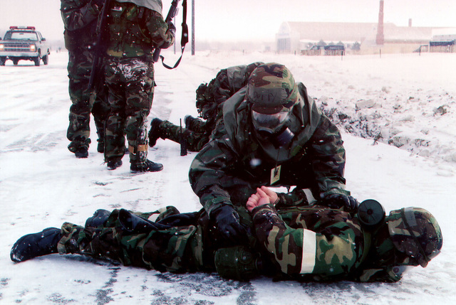 A member of the security police force apprehends an individual during Operational Readiness Evaluation (ORE) practice at the 174th Fighter Wing in Syracuse, New York