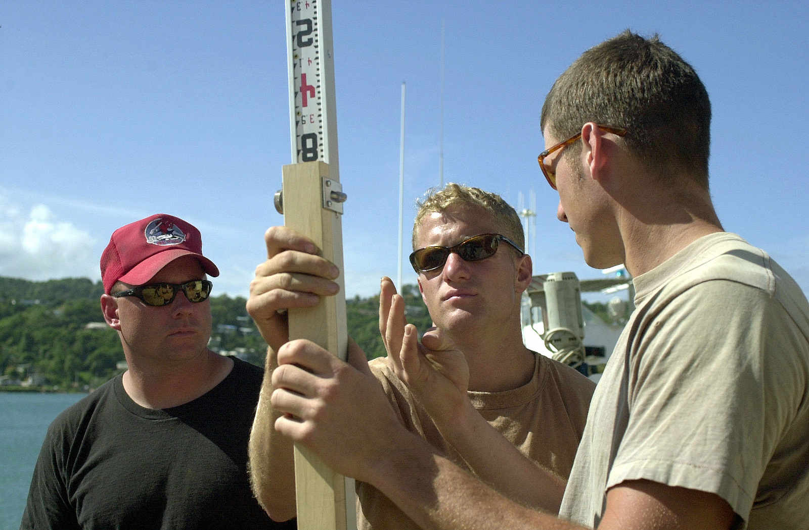 Members of the 820th Red Horse Squadron, Nellis Air Force Base, Nevada, discuss measurements during the construction of new Marine barracks being built during Operation NEW HORIZONS in Castries, Saint Lucia. Approximately 100 Marine, Army and Air Force personnel have deployed to Saint Lucia as part of New Horizons. The exercise has a two fold mission of readiness and humanitarian assistance in the Caribbean and Latin America