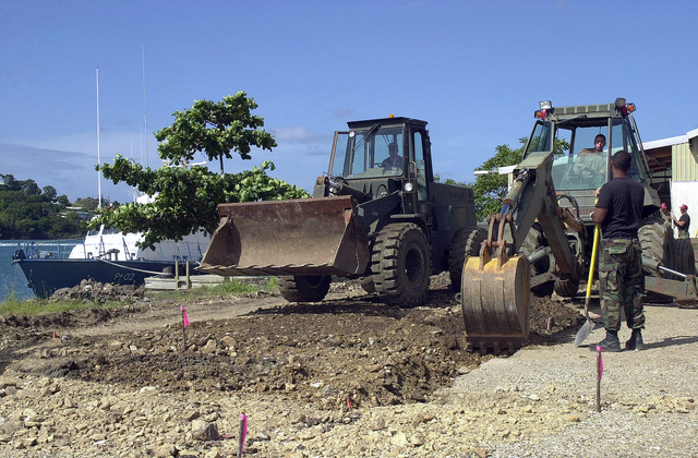 Members of the 820th Red Horse Squadron, Nellis Air Force Base, Nevada, prepare the ground with bulldozers and backhoes for construction of new Marine barracks during Operation NEW HORIZONS in Castries, Saint Lucia. Approximately 100 Marine, Army and Air Force personnel have deployed to Saint Lucia as part of New Horizons. The operation has a two fold mission of readiness and humanitarian assistance in the Caribbean and Latin America