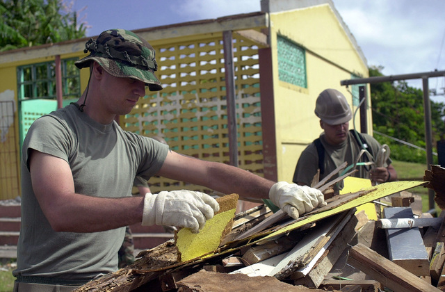 US Marine Corps Lance Corporal Drew Fisher of the 8th Engineer Support Battalion, 2nd Fleet Service Support, Charlie Company, cleans up the site after completely gutting the inside of the Babonneau community center in Saint Lucia. Approximately 100 marines, soldiers and airmen have deployed to Saint Lucia as part of Exercise NEW HORIZONS. New Horizons has a two fold mission of readiness training and humanitarian assistance in the Caribbean and Latin America