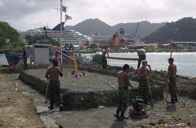 Members of the 820th Red Horse Squadron, Nellis Air Force Base, Nevada, work to prepare a site for building new Marine barracks in the city of Castries, Saint Lucia, in support of Operation NEW HORIZONS. Approximately 100 marines, soldiers and airmen have deployed to Saint Lucia as part of New Horizons. The operation has a two fold mission of readiness training and humanitarian assistance in the Caribbean and Latin America