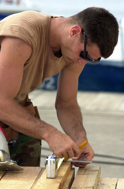 US Air Force AIRMAN Nathan Geldner of the 820th Red Horse Squadron, Nellis Air Force Base, Nevada, measures and marks some lumber for the building of new Marine barracks in Castries, Saint Lucia, in support of Operation NEW HORIZONS. Approximately 100 Marine, Army and Air Force personnel have deployed to Saint Lucia as part of New Horizons. The operation has a two fold mission of readiness training and humanitarian assistance in the Caribbean and Latin America